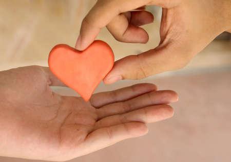 Send red heart plasticine Stock Photo