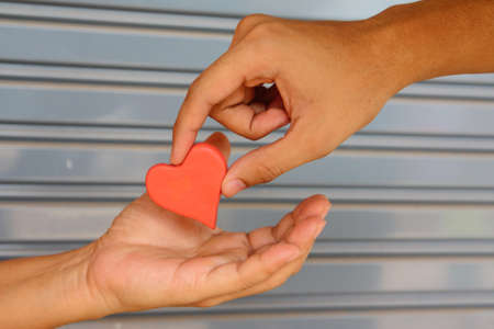 Giving red heart plasticine