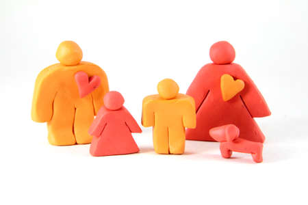 Family concept from plasticine. Father,Mother,Child and dog Stock Photo