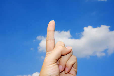 One finger and blue sky photo