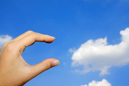 hand and blue sky