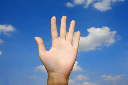 hand and blue sky photo