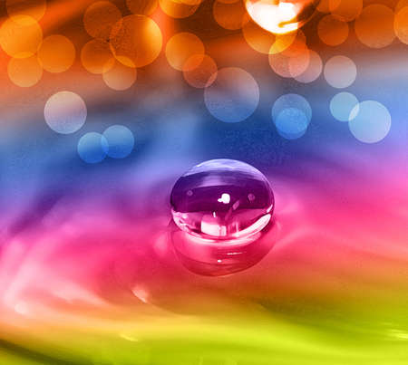 Falling water drop on colorful background