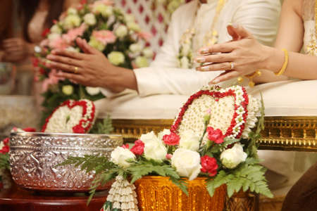 Hands Pouring Blessing Water in Thai wedding ceremony