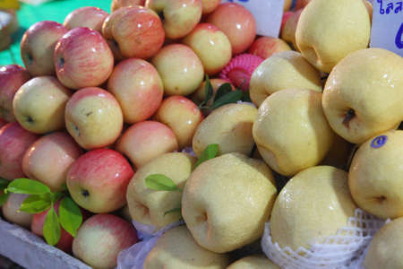 Red apples and pears in the fresh market  Stock Photo