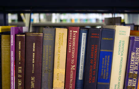 Yogyakarta, Indonesia - March 3, 2021: Old Ecology books on the bookshelves in the library