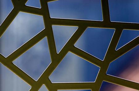 Irregular pattern of white metal windows, backlight, for background