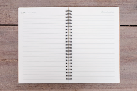 notebook on wooden table photo