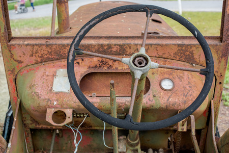 old tractor: Steering Wheel  of Rusty Old Tractor