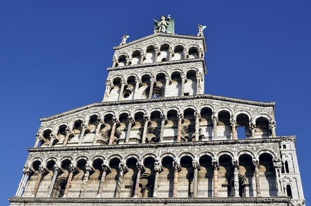forefront: Facade of the basilica San Michele in Foro in Lucca. Tuscany, Italy.