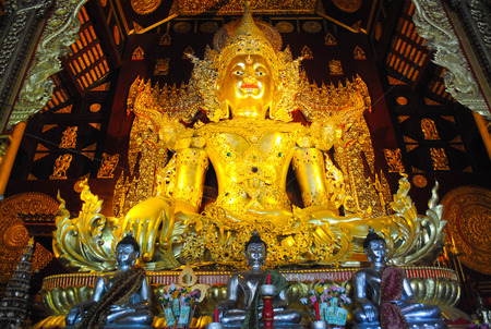 influenced: Myanmar influenced Buddhist statue of Goo Tao Temple, Chiang mai, Thailand Editorial