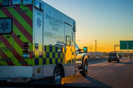 Yellow Charleston EMT truck driving on the highway towards North Charleston 写真素材 - 92142087