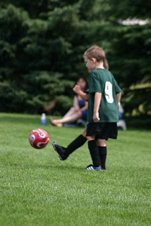 Kids playing soccer game on a hot day Stock Photo