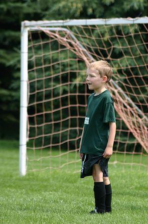 tending: Tending goal during soccer game on hot day Stock Photo