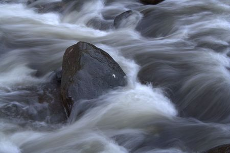 Longer exposure of rapids with rocks taken in fall Stock Photo