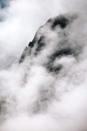salkantay: Mountain side shrouded in  fog and mist on the Salkantay Trek, Peru. Stock Photo