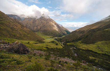 salkantay: Campsite nestled among the tall peaks that line the Salkantay Trail in Peru.