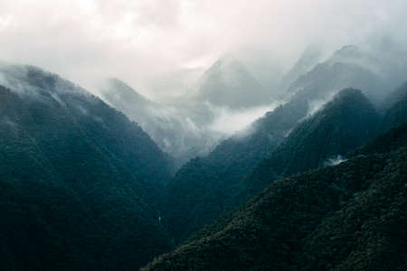 andes mountain: Fog falls over the Andes Mountain range. Stock Photo