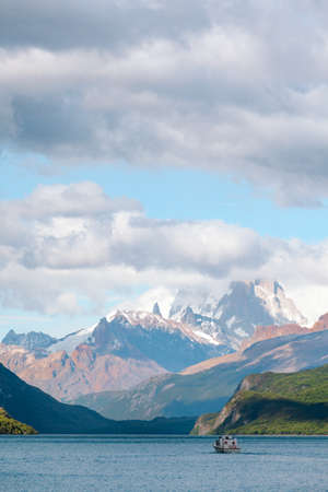 roy: Ferry travels towards the shrouded Monte Fitz Roy -  Laguna del Desierto - Chile Stock Photo