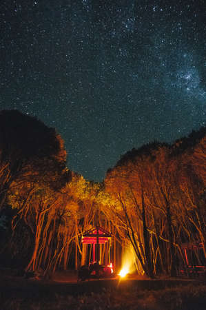 cole: Campfire shines bright against the starry sky - Cole Cole Beach - Chile Stock Photo