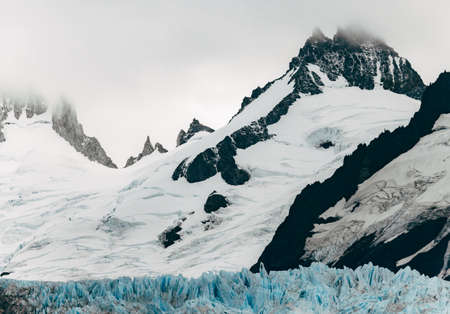 chalten: A spiked glacier at the bottom of jagged mountain peaks near El Chalten, Argentina