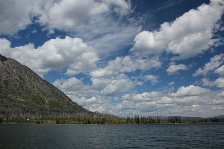 Clouds float above Jackson Lake and the Tetons