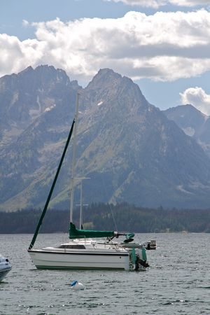 A sailboat on Jackson Lake under the Grand Tetons