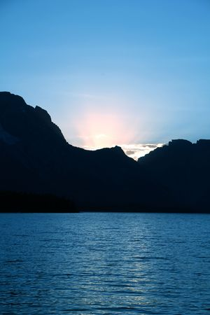 Sunset behind the Tetons over Jackson Lake