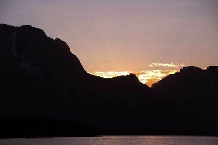 A beautiful sunset behind the Grand Tetons Фото со стока