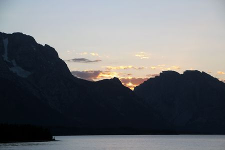 Sunset behind the Grand Tetons and Jackson Lake
