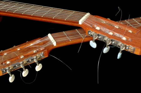 instrumentalist: crossed tuning pegs on twin classical guitars Stock Photo