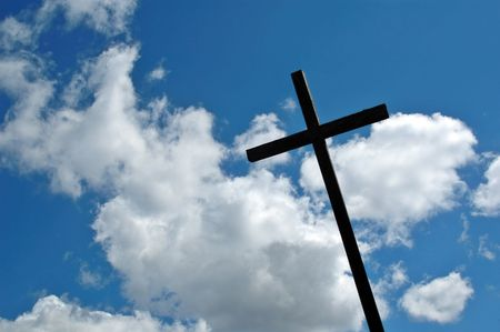 catechism: Cross and cloudy sky Stock Photo