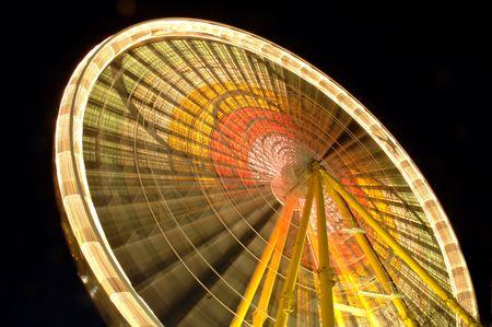 Ferris wheel at night, in movement. photo
