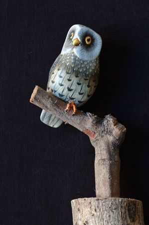 Painted Wooden Owl On A Branch The Owl Is The Symbol Of Magic