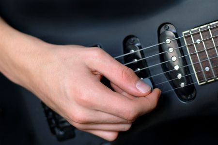 Playing guitar with a pick
