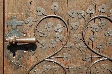 majesty: Antique massive wooden door in Ensisheim church. (Alsace, France) Stock Photo
