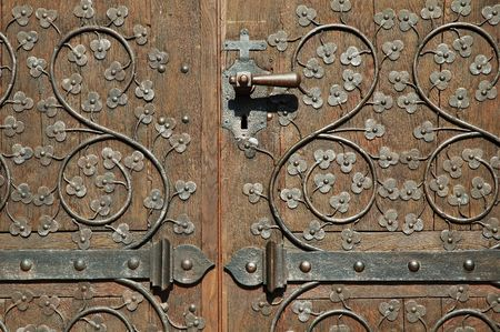 hand carved: Antique massive wooden door in Ensisheim church. (Alsace, France) Stock Photo