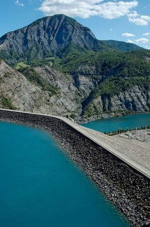 alluvial: The lake was formed by the Barrage (dam) de Serre-Pon�on that was built across the Durance just below where the Ubaye joined from the southeast. The 123m-high dam was started in 1955, built from an alluvial clay soil from the bed of the Durance.