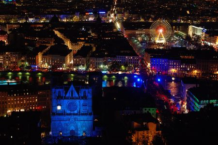 Lyon is turned into a live public art show with its annual festival of light at December 8th. The place Saint Jean and its cathedral  has been transformed into a theatre of lights for the festival. photo