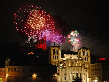 independance: Colorful fireworks sparkle over the basilica (Fourviere) and the cathedral (St Jean) in the city of Lyon (France) 14 july is the French national Day. It is the symbol of the end of the monarchy and the beginning of the Republic.