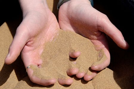 impermanent: Image of sand flowing from hands.