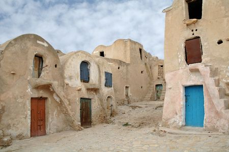 holyday: In these ksour,  the semi-nomadic families kept their possessions while they went on their wanderings, each  having its own ghorfa (store-room). The ksours have been featured in several Star Wars movies. Stock Photo
