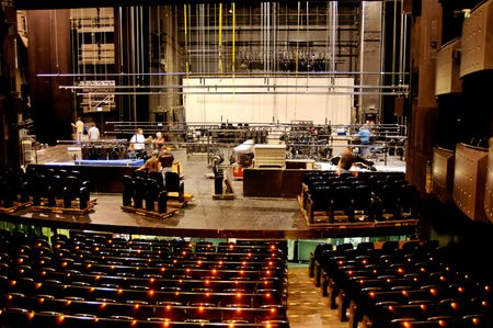 lecture theatre: Technicians start to pack everything up at the end of the show. Stock Photo