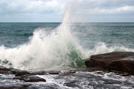 Waves breaking on the rocky coast of Normandy (France) Stock Photo - 2105975
