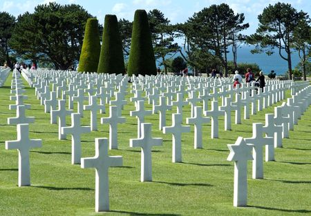cross armed: The cemetery is located on a cliff overlooking Omaha Beach (one of the landing beaches of the Normandy Invasion) and the English Channel. This pool is a link between visitors and the channel.