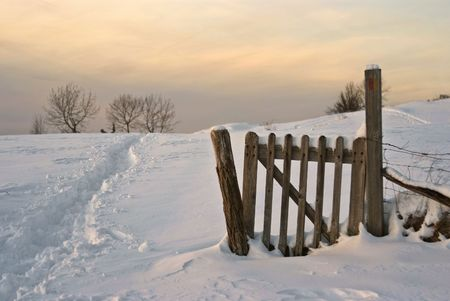 Fence, field ans snow : typical snowy lanscape in french jura, at dusk Stock Photo - 2453700