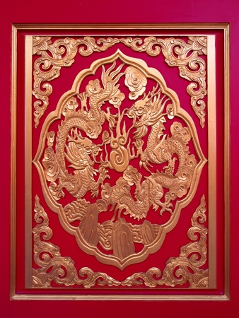 Golden Chinese Dragon in red wall ,temple in thailand Stock Photo - 10008687