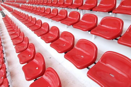 thep: Red seat at Thep Hasadin Stadium in Thailand Editorial