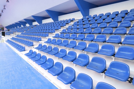 thep: Blue seat at Thep Hasadin Stadium in Thailand Stock Photo