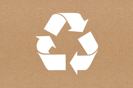 White recycle sign on recycled paper background photo